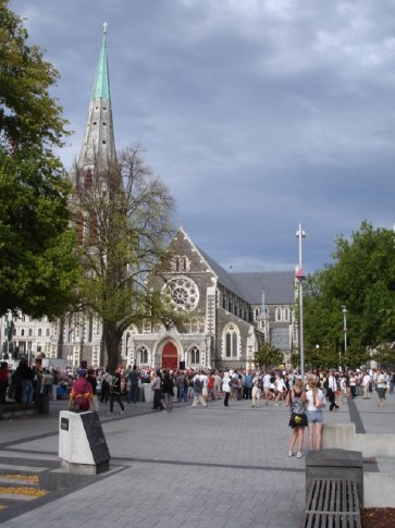 A street performer draws a crowd in Cathedral Square.