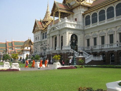 Some monks outside of the Grand Palace