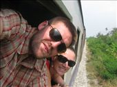 Hanging out the train window on our way from Bangkok to Chumphon.: by erin_and_pete, Views[333]