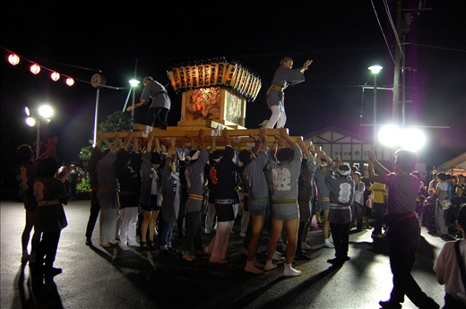 Yuni's community united to celebrate one of the larger festivals 'Bon-dori' in front of the town train station. With synchronised shouts the men lift the shrine and tap the wood to rest their weary shoulders.