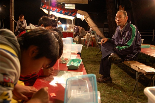 Yuni's population is shrinking and aging as young adults move away to make their lives in the cities. This year's autumn festival was almost deserted, but still managed to attract a few loyal enthusiasts to the game and food stalls.