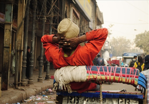 one of the rickshaw pullers in Chandni Chowk.