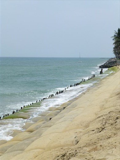 The beach at Hoi An - sandbags and stakes but OK