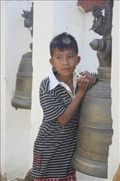 A young Burmese boy plays with a laser pen near a popular pagoda in Bagan.: by evalentine, Views[159]