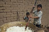 Two boys mix sugar cane over heat to prepare a regional specific molasses : by eyeofblitzcraig, Views[154]