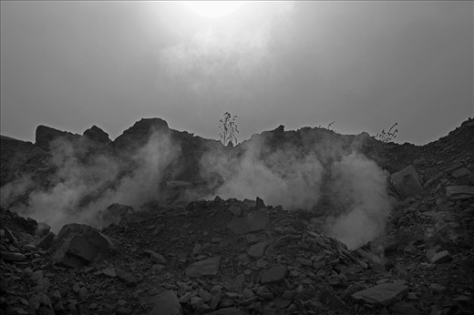 Jharkhand, northeastern India: Black dust and gasses shoot up from the ground.