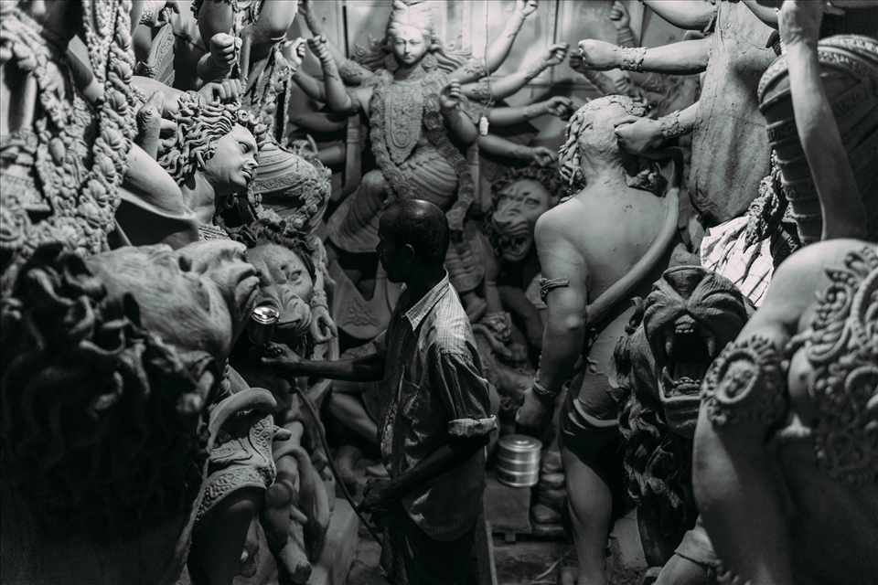 In God's Image - Layers of this clay are added to wooden frames, built to support several deities in standard poses, normally representing popular episodes from the epics. The attention to detail required of these artists means that this is tedious work and though the festival itself lasts only a week, the work goes on throughout the year.
