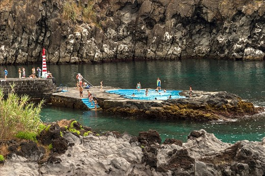 """Pool carved in the rocks near the village """"Caloura"""" -Picture 6451-   Azoreans enjoy life. They are having siestas, take baths in hot springs or a swimming pool right in the rocks. They keep things real and natural."""