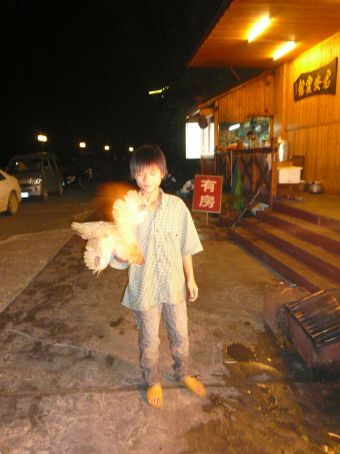 FRESH CHICKEN! This little boy is taking it to the butcher...