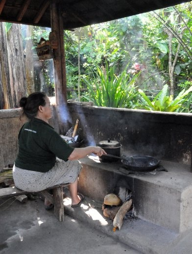 Kitchen with a view - and elderly Balinese woman cooking for her family, while them men work in the rice fields.