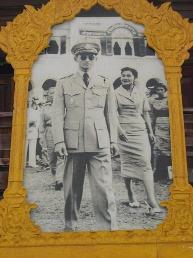 A poster in Chiang Rai of an old picture of the King & Queen of Thailand