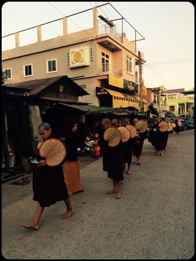 Hungry Buddhist monks lining up for rice at 6.30 am. They don't have dinner for religious reasons so they are rather hungry in the morning.