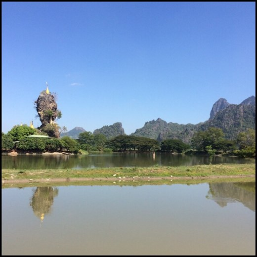 Golden stupa on top of a rock in Hpa-an.