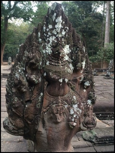 Cobra statues like this one guard the  entrance gate of every Angkor temple.