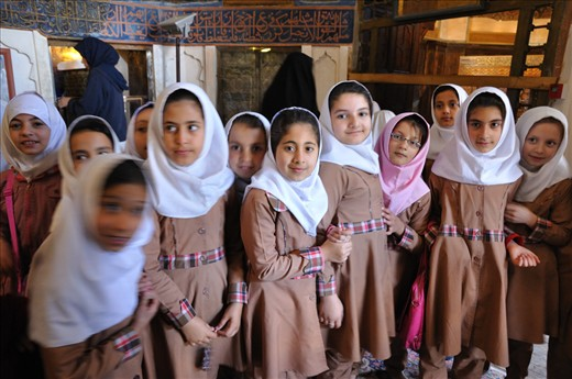 Whenever I pass a group of schoolchildren, I greet them with a wave and say, 'Salam' (Persian for hello), which encourages them to return the greeting. Generally, I do not linger unless the occasion requires it.   Such an occasion arose when I met a large class of schoolgirls inside the Shaikh Safi Mausoleum in Ardabil. They had separated into smaller groups of friends who peeked at me with excited curiosity. I greeted the group nearest to me then paused. Their eyes full of anticipation.    'My name is Fiona. I am from Australia.' I held out my hand. After a few handshakes, the rest of the children approached, individually announced their names. We shook hands, gave each other high-fives.   I took this photo before the entire class of 30 children or more, gathered in front of me. It was a special moment not interrupted by an attempt to capture it. This was the future of Iran.