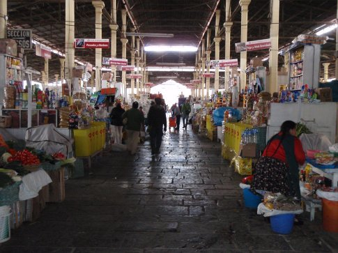 Huge market in Cusco - everything from fruit juice to ceviche to handbags.  Stray animals included.  Cusco, Peru.