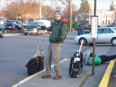 Dave with our famous luggage on wheels: two backpacks, two suitcases, and accessories (bags with food in them attached to suitcases). It all works. We've walked miles with this stuff in tow! Now, we've added a laptop as well, and bought a backpack specifically for it.
