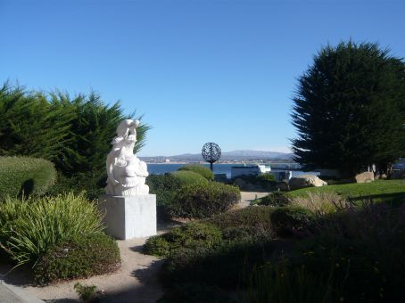 Statues, sculptures, and landscaping abound, adorning the sea views