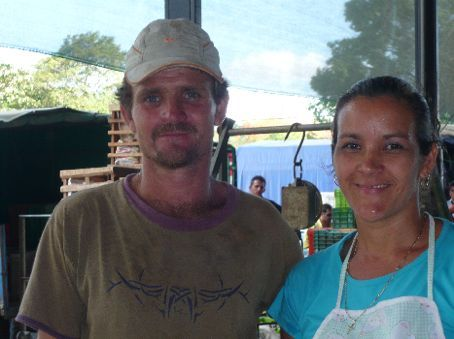 At the Feria (farmer's market), the lovely couple that prepared orange juice and coconuts.