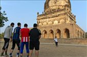 A group of young men playing soccer in the open area around one of the tombs.: by frozenimprints, Views[136]
