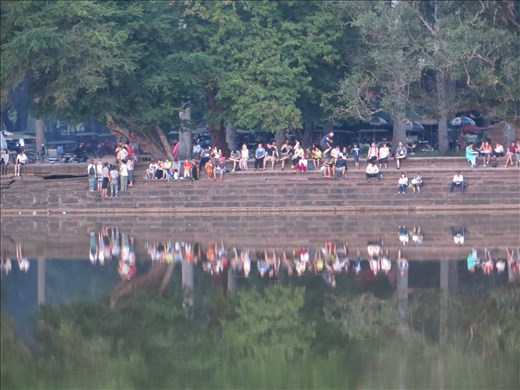 People sitting at the Angkor Wat temple