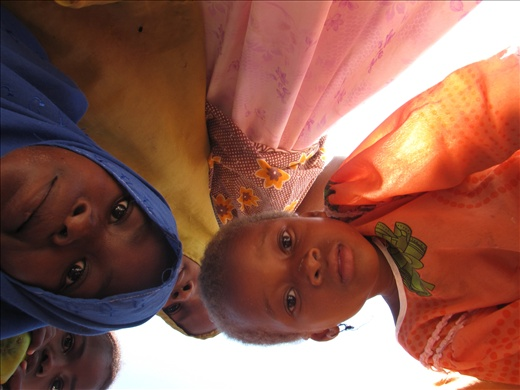 Inquisitive; the young Muslim girls inspect my camera before approval for photos.