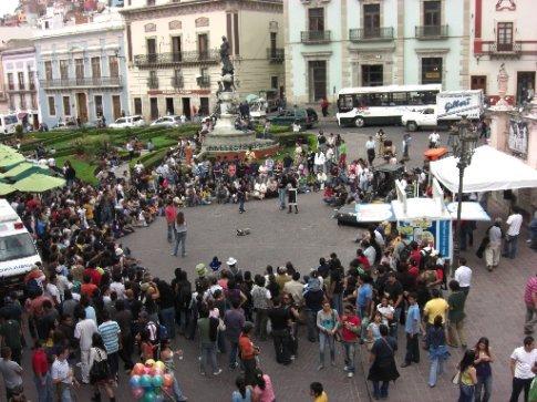 A crowd gathering around a street performance