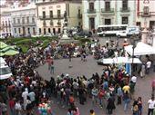 A crowd gathering around a street performance: by gemma, Views[954]