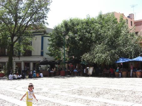 a small plaza with cafes