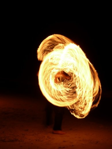 Fire dancing at half moon party.