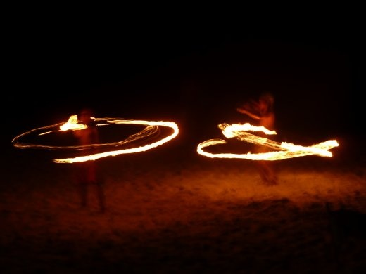 Children doing fire dancing. One is 10 and the other 12!