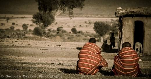 A couple of Maasai tribesmen take some time out in the Maasai Mara, Kenya