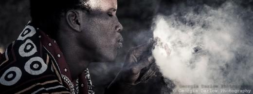 A Maasai tribesman makes fire
