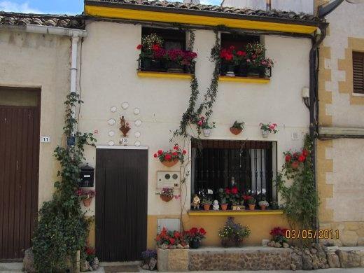 A pretty house with lots of flowers along the Camino