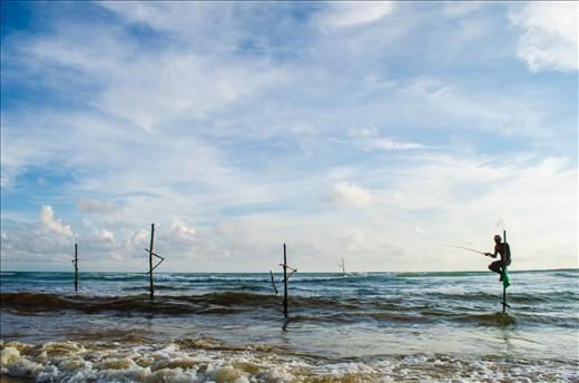 An elusive stilt fisherman keeps alive a dying art