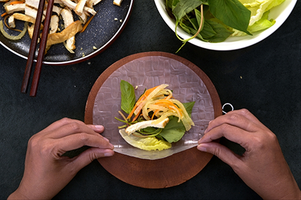 Rice paper becomes wrapping cover with many inside layers made by mixed vegetable, tofu, carrot and manioc
