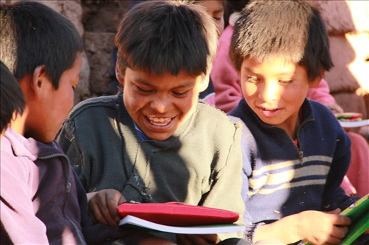 Peruvian students first time receiving pencils and notebooks