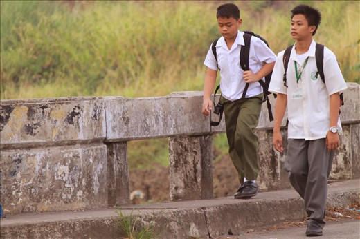 2 brothers/friends as They walk to school. while  conversing Cavite Philippines