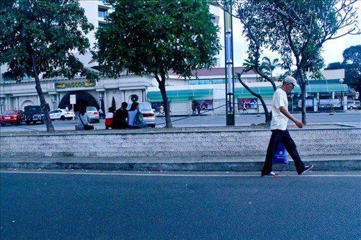christmas day, as the old man walks alone delivering his presents to his family. Baclaran Paraniaque Philippines