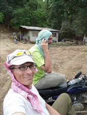 Matt and I on the sidecar scouting for sites to build more housing. I'm the cute one in pink - he's the boss on the phone while driving...do you drive a sidecar or ride a sidecar? hmm.: by gpzmike, Views[234]