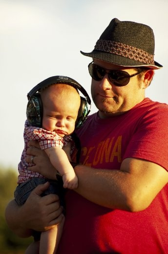 I'm not sure this little guy was enjoying the tunes as much as his dad...