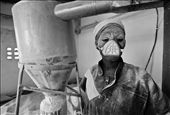 This student had to put the freshly produced maïze flour in bags.  A lot of flour escapes during this process. There was only one mouth mask at that time, so she got to use it. : by grarvdb, Views[188]