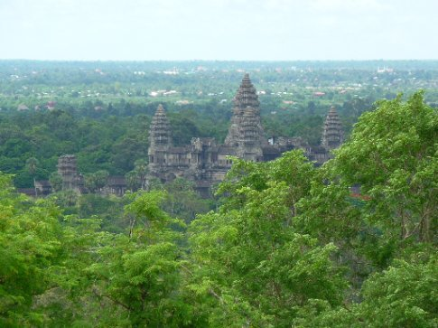 Ah ha!  Our first glimpse of Angkor Wat through the trees.  We are standing on the hill-top temple of Phnom Bakheng, our first temple of many...be prepared for lots of temple shots!
