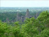 Ah ha!  Our first glimpse of Angkor Wat through the trees.  We are standing on the hill-top temple of Phnom Bakheng, our first temple of many...be prepared for lots of temple shots!: by gretch_costa, Views[113]