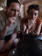 Anika and Dale drinking communal 'happy water' at Sop Sim Noy - the locals were pretty rosy by the tmie we turned up.: by gretch_costa, Views[168]