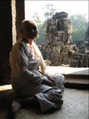 The Lady Monk who for a photo enticed me into the Buddist shrine to put some incense sticks in the pot for good luck. Obviously a little donation was need too.: by h1annah, Views[1259]