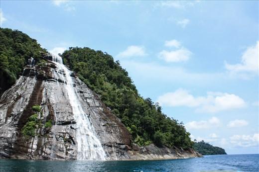 Mursala Waterfall in Indonesia, a 40 m waterfall falls directly into the Sea