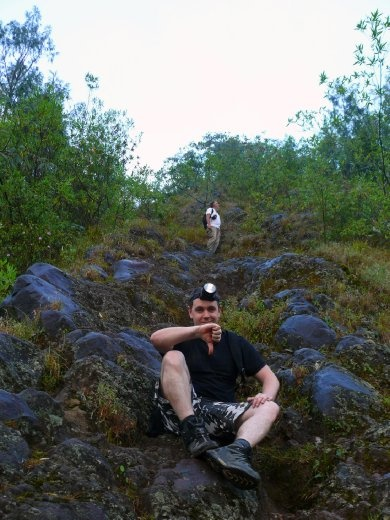 A disappointed Jesse sitting on the lava path track, with Stuart behind him.