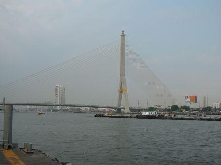 King Rama 8 Bridge + tiny boat hauling huge boat-train