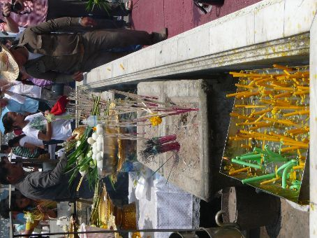 Offerings for Buddha at The Grand Palace - candles, incense, eggs, fruit, water